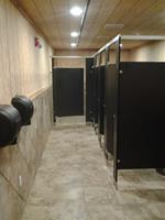 Floor mounted, overhead braced toilet partitions